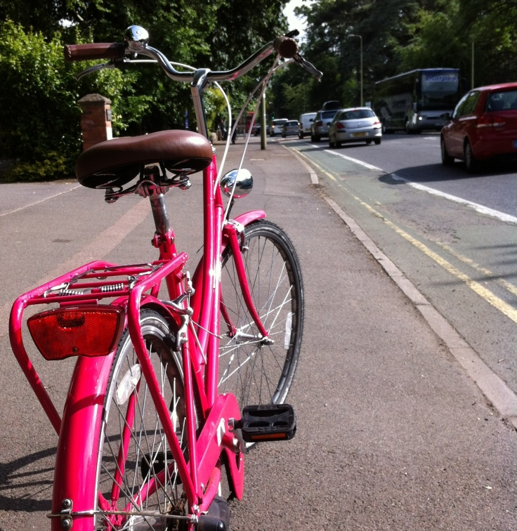 My flamingo pink three speed bike (next to the cycle path outside the Oxford Careers Service)